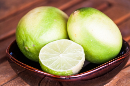 wholes: Close up fresh lime wholes and slice Stock Photo