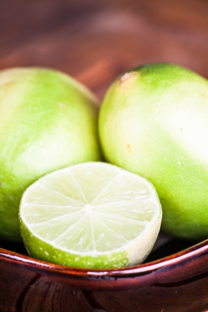 wholes: Close up fresh citrus lime wholes and slice Stock Photo