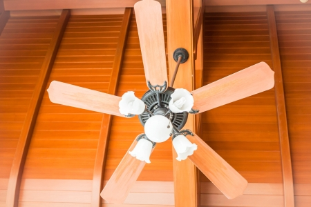 Close up beautiful hanging ceiling fan with glass lamps photo