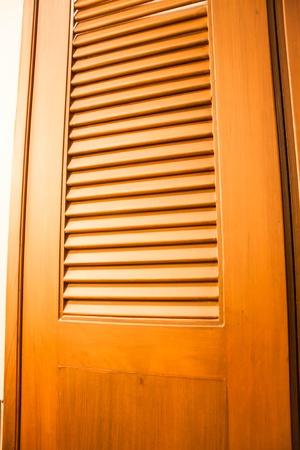 Wooden door of wardrobe with warm light photo