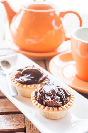 Tea time with crispy chocolate tarts, stock photo photo