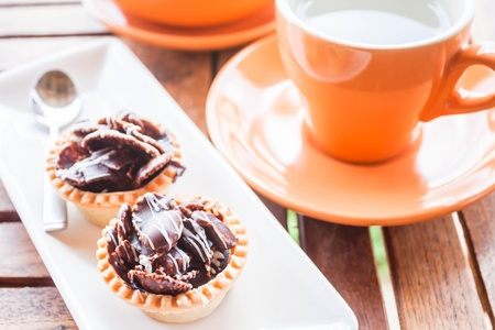 Hot tea and crispy chocolate tarts, stock photo photo
