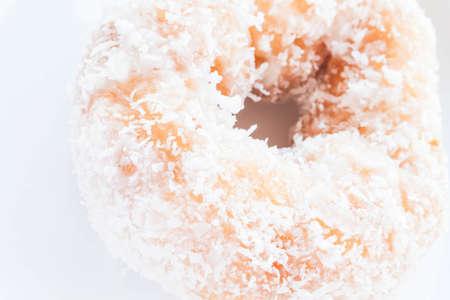 Piece of vanilla coconut donut up close, stock photo photo
