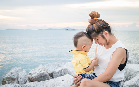 Cute asian boy playing with his mother, stock photo photo