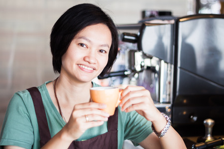 Asian barista enjoy her coffee, stock photo photo
