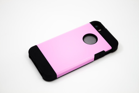 Smartphone with pink case isolated on white background, stock photo
