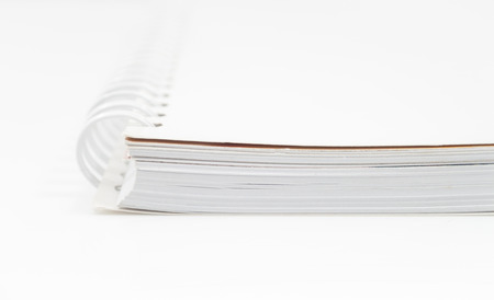 moleskine: Closeup spiral notepad isolated on white background, stock photo