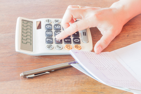 calculated: Businesswoman calculated account balance, stock photo