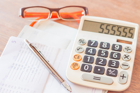 work station: Work station with calculator, pen and eyeglasses, stock photo Stock Photo
