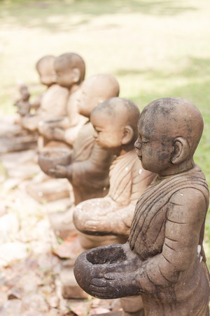 ordinate: Little monk clay doll decorated in garden, stock photo