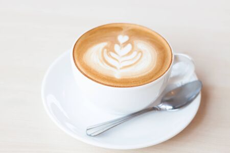 Coffee cup with latte art, stock photo