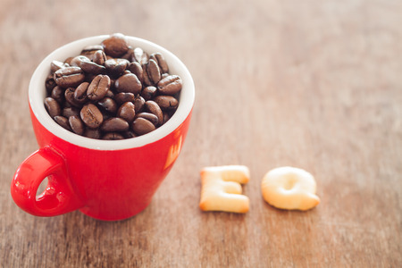eq: EQ alphabet biscuit with red coffee cup, stock photo