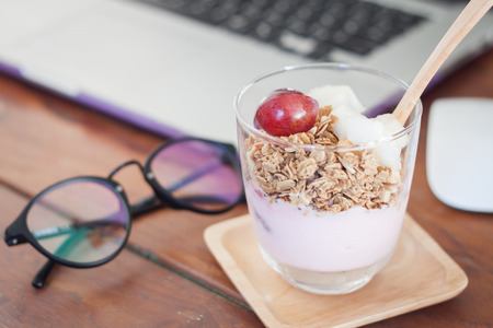 work station: Granola with fruits on work station, stock photo