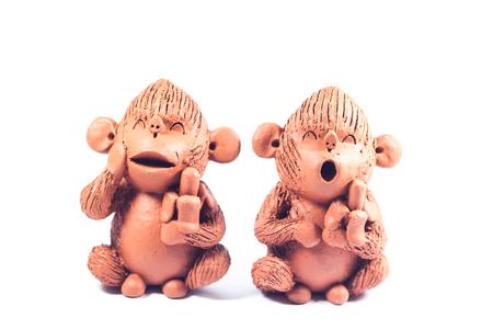 Close-up monkey clay dolls isolated on white background, stock photo