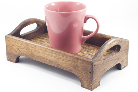 Brown mug on wooden tray isolated on white background, stock photo Stock Photo
