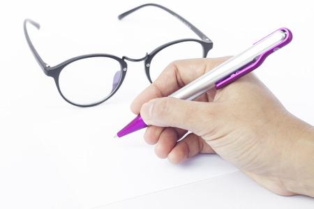 recipient: Hands writing recipient address on white envelope, stock photo