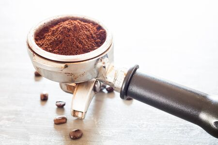 automat: Coffee grind in group with coffee bean, stock photo