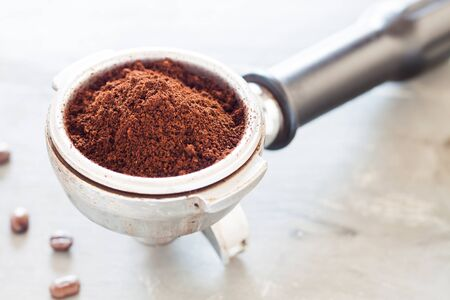 Coffee grind in group with coffee bean, stock photo