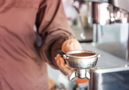 automat: Womans hand holding coffee grind in group with vintage style, stock photo Stock Photo