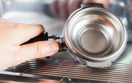 automat: Coffee grind in group with coffee machine, stock photo