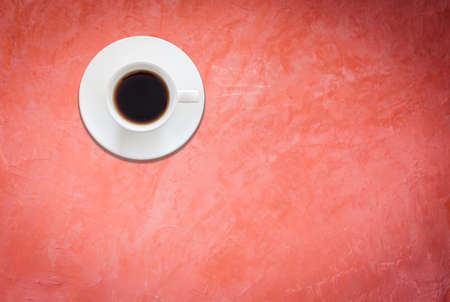 arabica: Top view of white coffee cup on red background, stock photo Stock Photo
