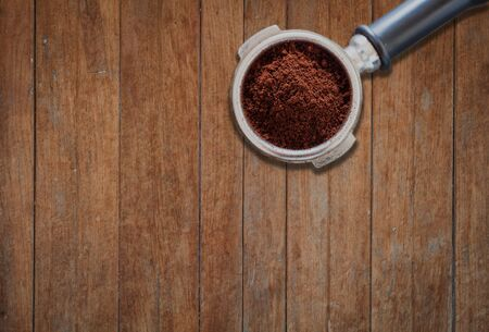 grind: Coffee grind in group on wooden background, stock photo Stock Photo