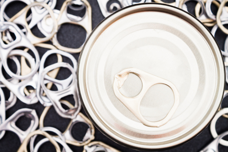 black metallic background: Ring pull cans opener on black metallic background Stock Photo