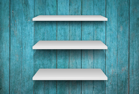 three shelves: Three white shelves on blue wooden interior texture background, stock photo Stock Photo