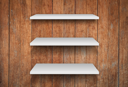 three shelves: Three white shelves on wooden interior texture background, stock photo