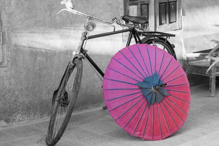 color in: Retro bicycle with red umbrella, Color in black and white conceptual, idea. Vintage, retro style