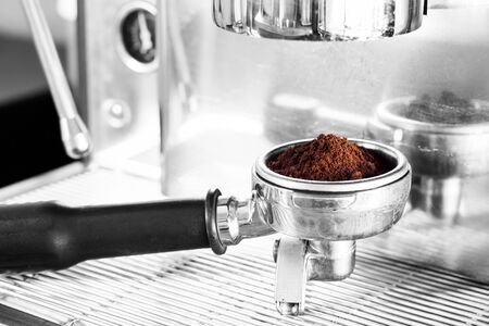 brew house: Coffee grind in group with black and white background, stock photo