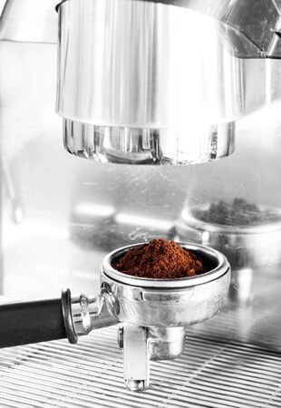 brew house: Coffee grind in group with black and white filter, stock photo