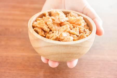 chins: Fried shrimp chins snack in wooden bowl, stock photo Stock Photo