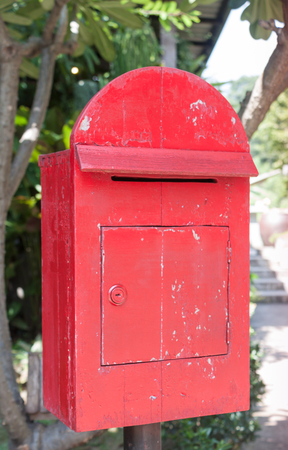 red post box: Old wooden red post box, stock photo Stock Photo