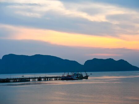 The pier on the beach in thailand Stock Photo - 13050507