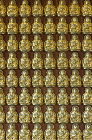 gold Buddha on wood wall is in Chinese church photo