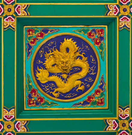 Decorative ceiling traditional chinese dragon image in chinese temple Thailand photo