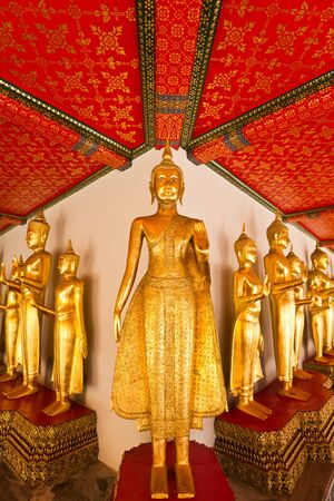 Row of Golden Buddha in Wat Pho, Bangkok, Thailand photo