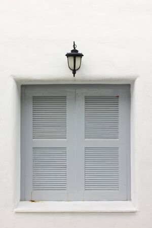 gray window on white wall photo