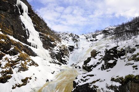 Frozen kjossfossen waterfall in Norway