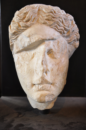 female stone head, Rome