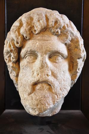 male stone head, Rome