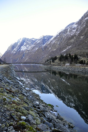 reflection of the mountain in Gudvangen fjordtell, Norway photo