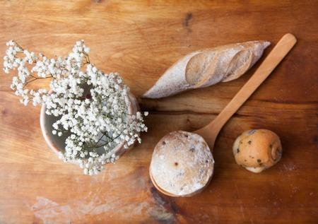 Bread Breakfast and flower on wooden background Stock Photo