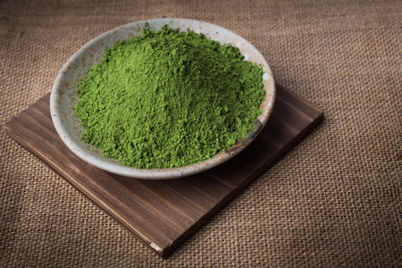 Green Tea powder on the plate, Natural Style. Focus on Green Tea powder.