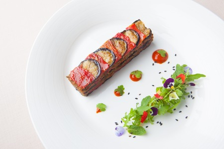 Lamb and eggplant grill with wild rocket salad, France menu on white dish Imagens