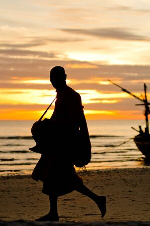 Silhouettes of monks on the beach,Hua Hin Thailand Stock Photo - 15363200