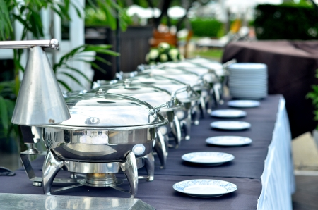 garden party: Buffet Table with Row of Food Service Steam Pans