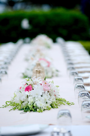 Long formal dining table Stock Photo
