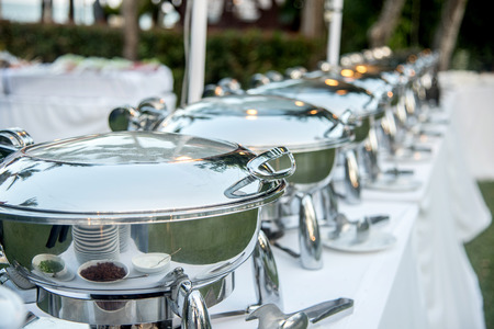 buffet dinner: Buffet Table with Row of Food Service Steam Pans